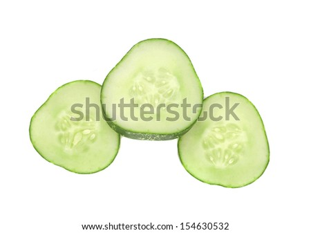 Three slices of cucumber. Isolated on a white background