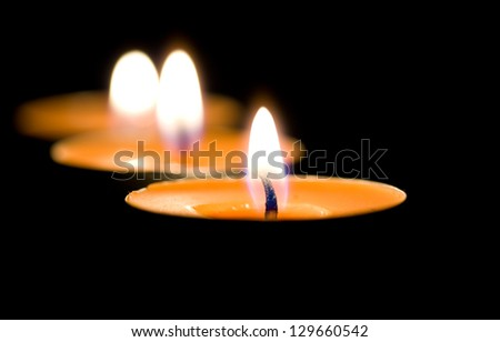 Three small candles or tea lights.