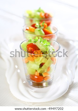 Three small vegetable salads served in glass for catering