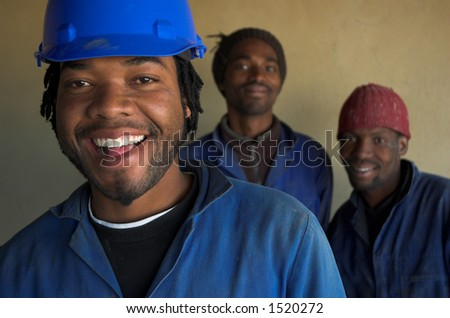 Three smiling building, plumbing construction workers
