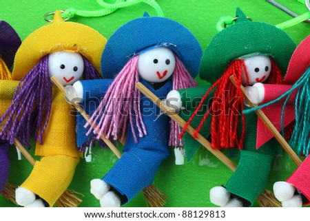 three snow witch doll with green background