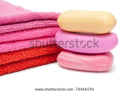 Three soaps and towels isolated on white