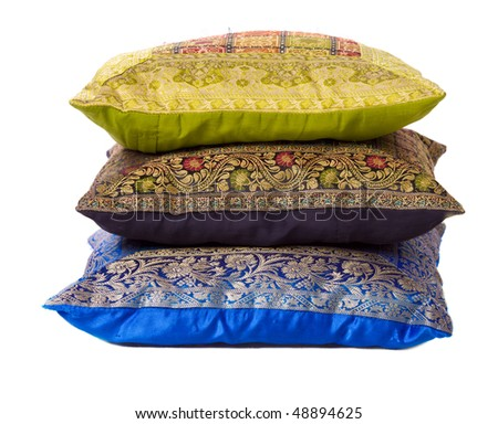 Three soft pillows lying one above another isolated on white