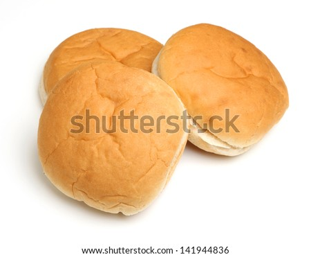 Three soft white bread rolls.
