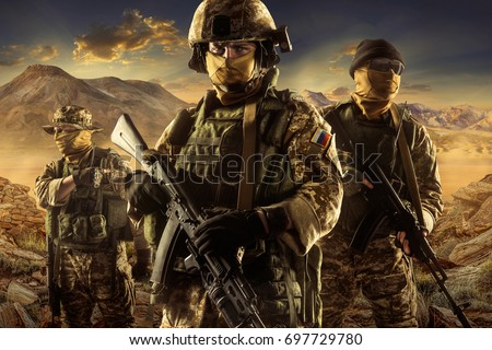 Three soldiers of russian mechanized infantry in desert of middle east  #697729780