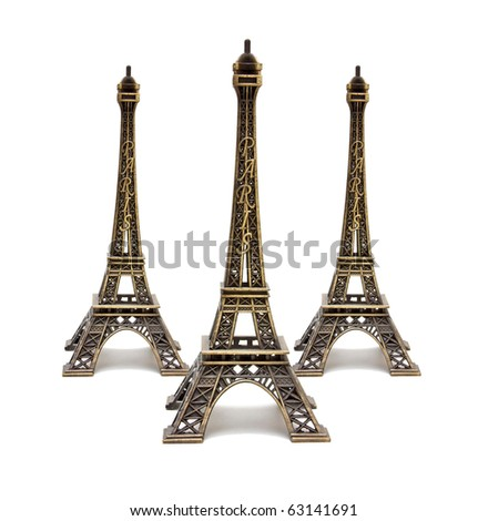 Three souvenirs Eiffel Tower isolated on white background