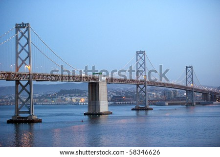 three spans of the bay bridge against the city of san francisco