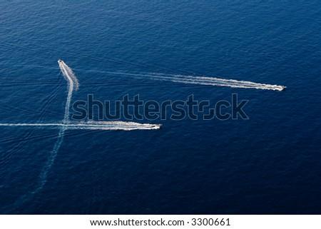 three speedy motor boat in the ocean