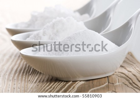 three spoons with different salt