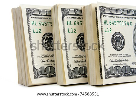 Three stack of $100 bills isolated on white background. Closeup