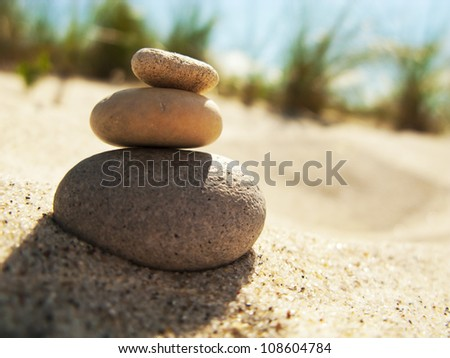 Three stacked stones on the beach