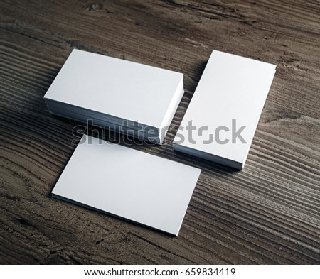 Three stacks of blank business cards stacks on wood table background. Template for your design. #659834419