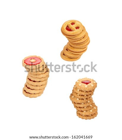 Three stacks of cookies with jam. Isolated on a white background.