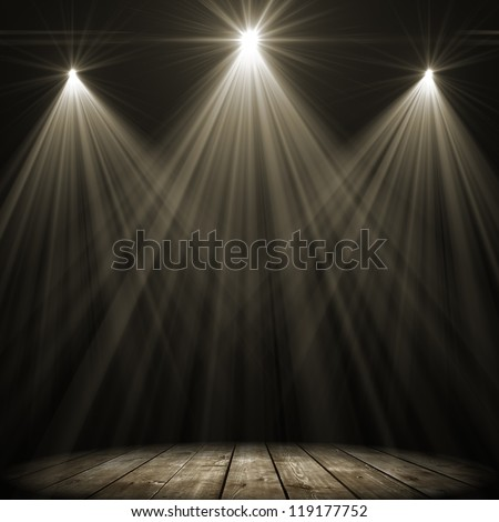 Three Stage Spot Lighting Over Dark Background