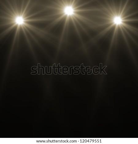 three stage spot lighting over dark background