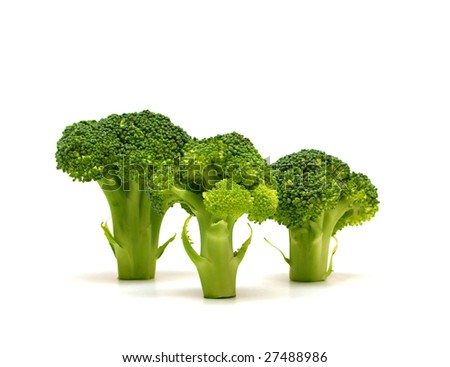 three stems of broccoli isolated