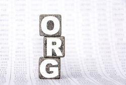 three stone cubes on the background of white financial statements, tables with the word org. Strong business concept