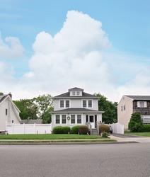 Three Story Suburban Home front yard walkway American Flag Curb Residential Neighborhood Street