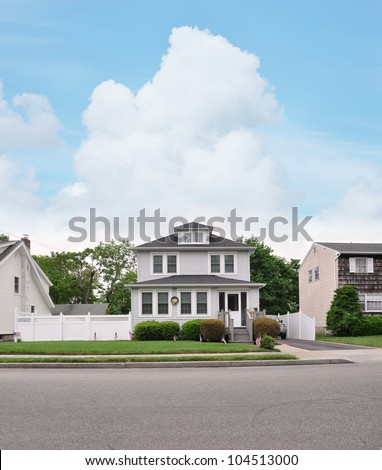 Three Story Suburban Home front yard walkway American Flag Curb Residential Neighborhood Street