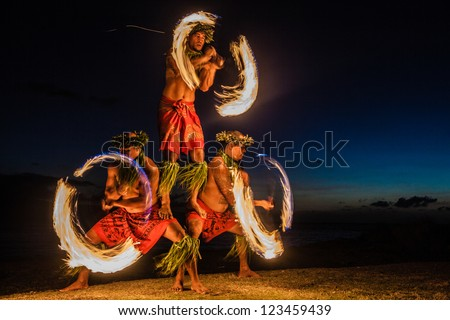 Three Strong Men Juggling Fire in Hawaii - Fire Dancers Zdjęcia stock ©
