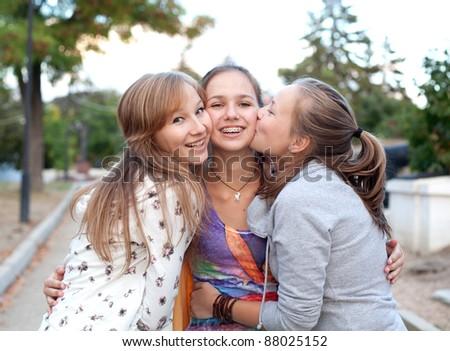 Three student girls having fun in the park