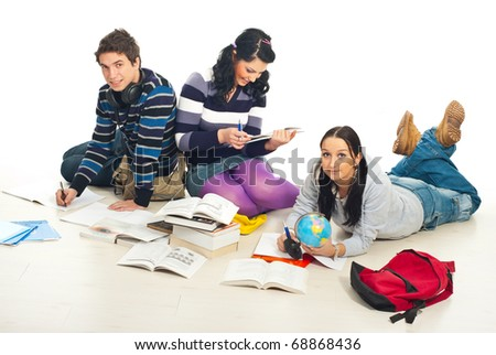 Three students make their homework together  and sitting on wooden floor in a home