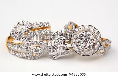 Three style of diamond rings, isolated on white.