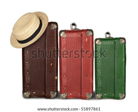 Three Suitcases with Summer Hat isolated on white background