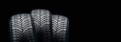 three summer modern tires on a black background. place for advertising and text copyspace
