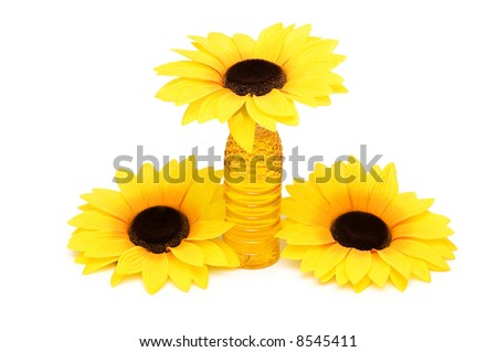 Three sunflowers and bottle of oil isolated on white