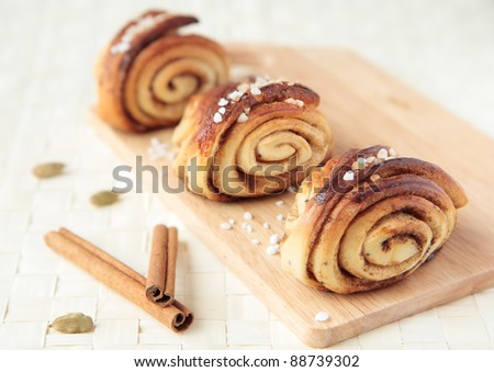 Three sweet rolls with cinnamon and cardamom