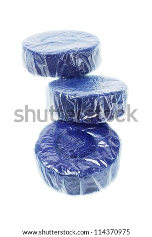 Three Tablets of Blue Toilet Bowl Cleaner on White Background