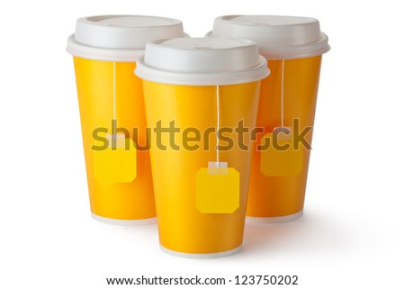 Three take-out teacups with teabags. Isolated on a white.