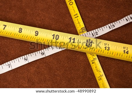 Three Tape Measures Crossed at 1 Ft ( 12 Inches )