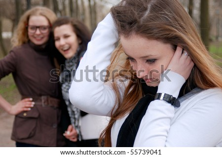 Three teenage girls in emotional scene in the park