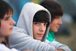 Three teenagers sat together