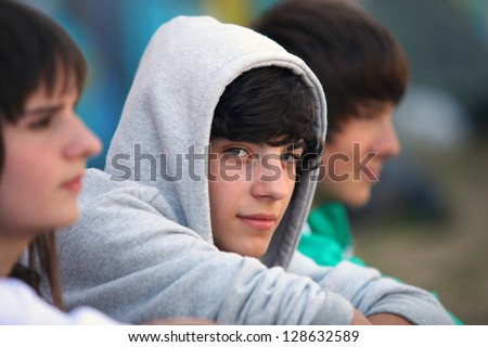 Three teenagers sat together