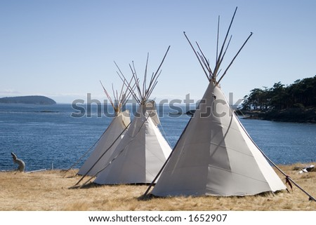 Three Teepees Near Water - stock photo