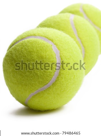 Three tennis balls isolated on white background with soft shadow.