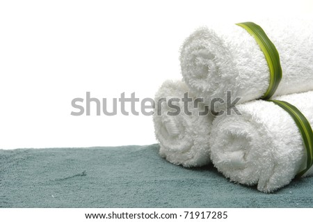Three terry multi-white towels on blue towel
