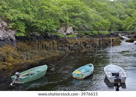 three tethered boats on a river at Badachro, NW Scotland
