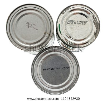Three tin cans with expired dates showing when the food is expired