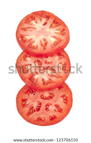Three tomato slices over a white background