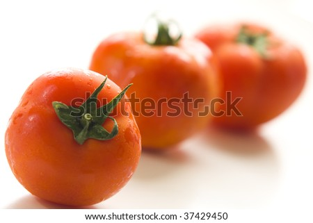 stock-photo-three-tomatoes-isolated-on-a-white-background-with-shallow-depth-of-field-37429450.jpg