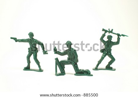 Three toy soldiers on a white background - stock photo