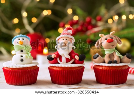 Three traditional decorated christmas cupcakes