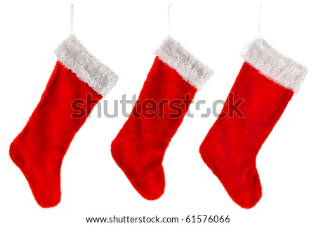 Three traditional fur red Christmas stocking. Isolated on white.
