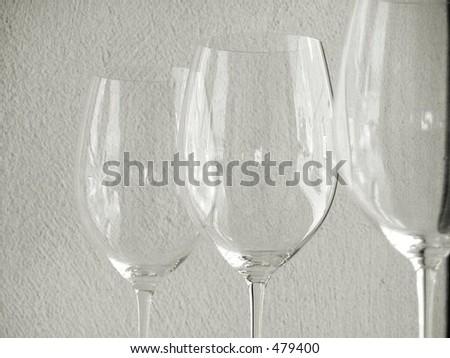 three transparent wine glasses