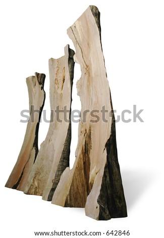 three tree trunk sculptures