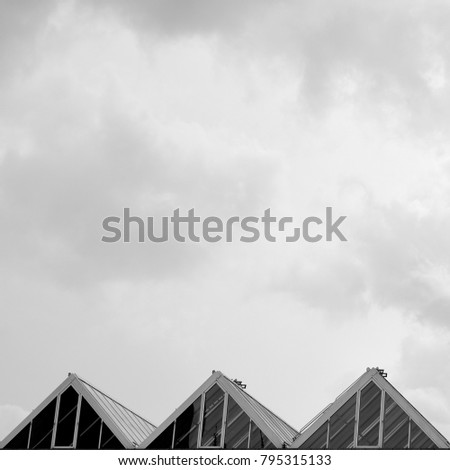 three triangles, cloudy sky in background #795315133
